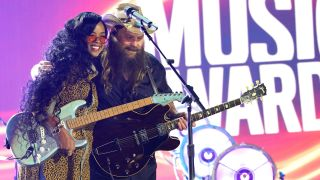 [L-R] H.E.R. and Chris Stapleton at the CMT Music Awards 2021