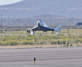 After its fifth glide test flight – the longest one yet – Virgin Galactic's first SpaceShipTwo passenger spaceship touches down on a runway at the Mojave Air and Space Port in California on April 22, 2011.