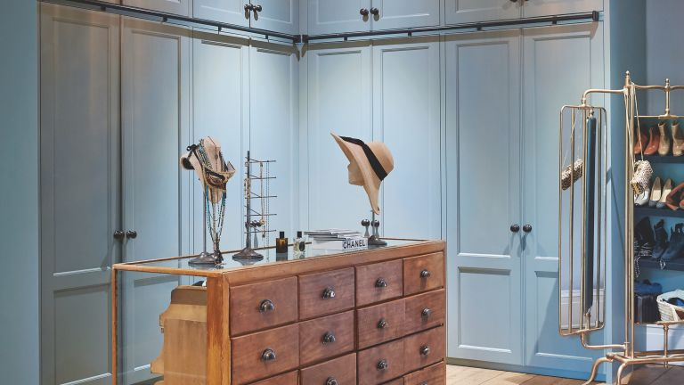 Blue dressing room with wooden island