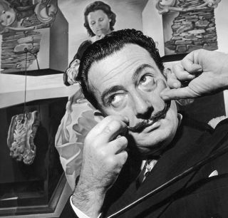 Salvador Dali (1904—1989) in London with one of his paintings in December 1951.