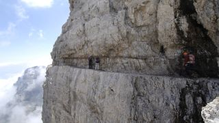 Climbers on a via ferrata route