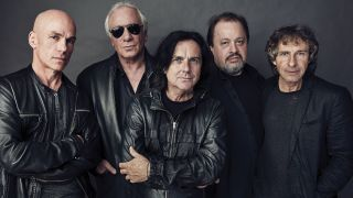 Marillion moody band shot against grey background