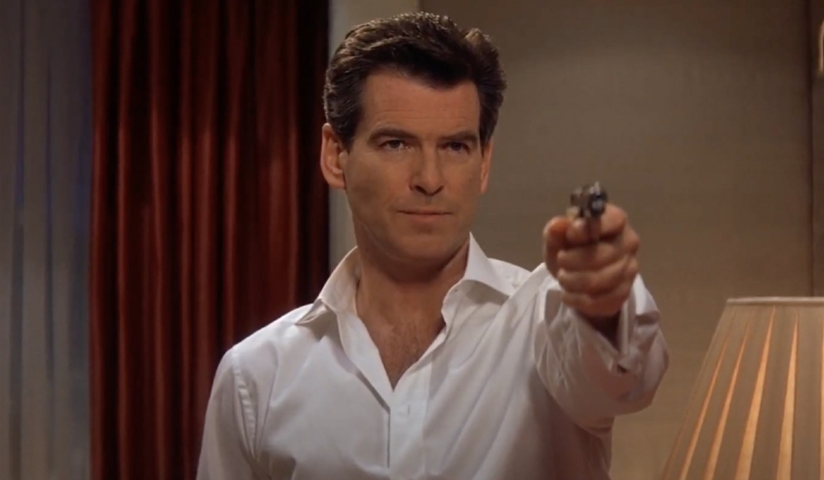 Pierce Brosnan aims his pistol, in a hotel suite, in Die Another Day