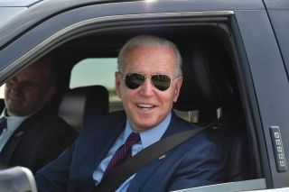 US President Joe Biden talks to the media after driving the new electric Ford F-150 Lightning at the Ford Dearborn Development Center in Dearborn, Michigan on May 18, 2021.