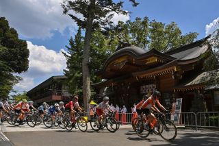 Cyclists in the peloton ride past the Okunitama shrine during the womens cycling road race of the Tokyo 2020 Olympic Games in Fuchu Japan on July 25 2021 Photo by Ben STANSALL AFP Photo by BEN STANSALLAFP via Getty Images