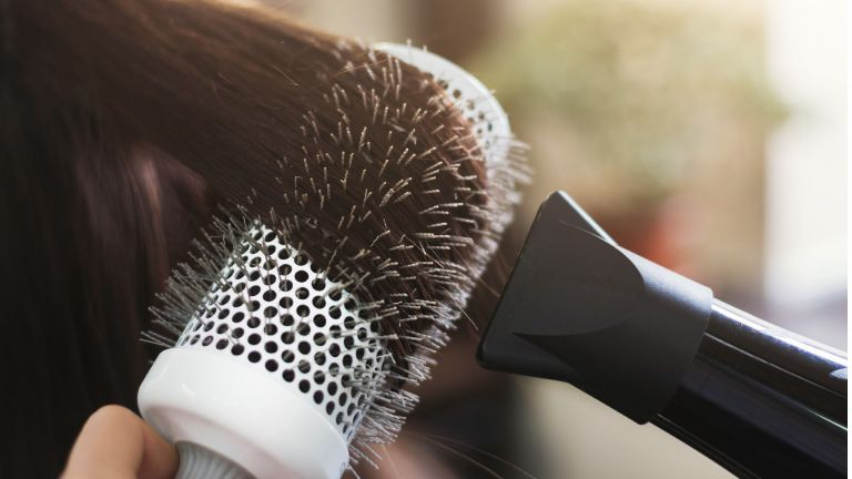 Close up of drying hair with a round brush