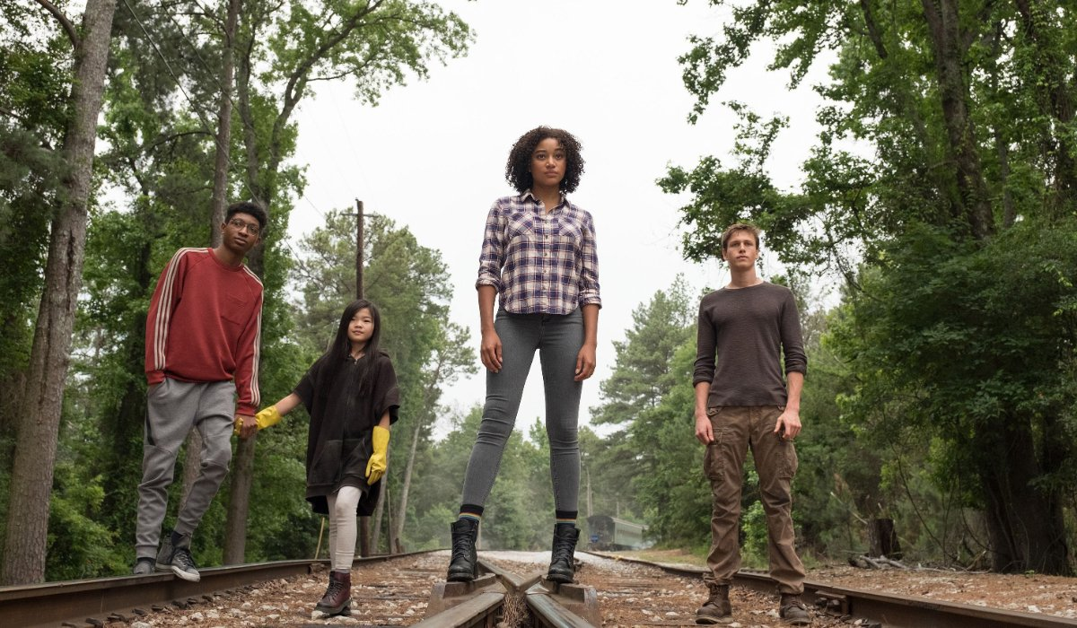 The Darkest Minds Amandla Stenberg walks railroad tracks with her fellow teens