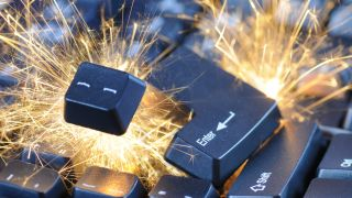 Black exploding computer keyboard with electric sparks