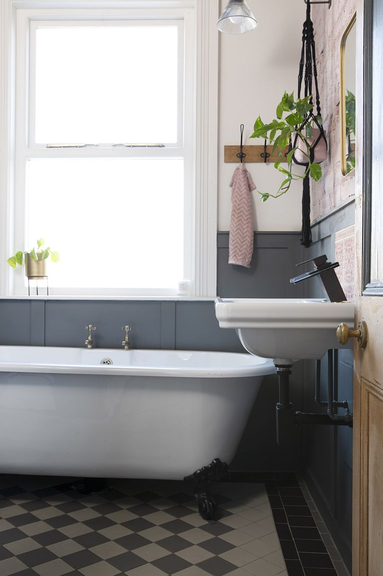 small bathroom with wall panels