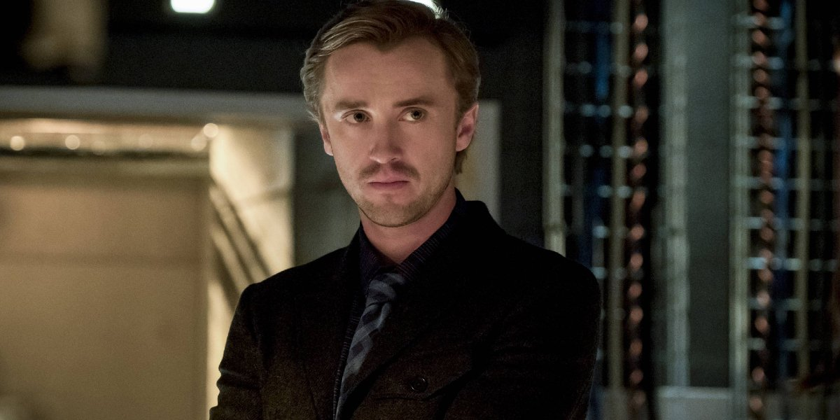 The Flash Tom Felton scowls in a server room