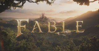 """Fable 4 logo that reads just """"FABLE"""" in stylized text in front of a forested landscape at sunset looking at a large, fantasy city in the distance between several hills."""