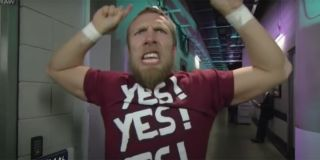 Daniel Bryan doing the Yes chant with his arms raised.