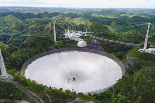 The massive dish at Arecibo Observatory as seen in spring 2019.