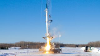 A bluShift Aerospace Stardust 1.0 rocket launches on its first low-altitude test flight from a runway at the Loring Commerce Centre in Limestone, Maine on Jan. 31, 2021.
