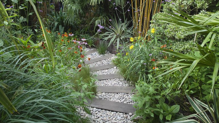 garden sleeper ideas used as path with gravel and plants either side
