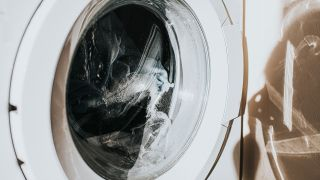 Can you wash shoes in the washer? Image of washing machine