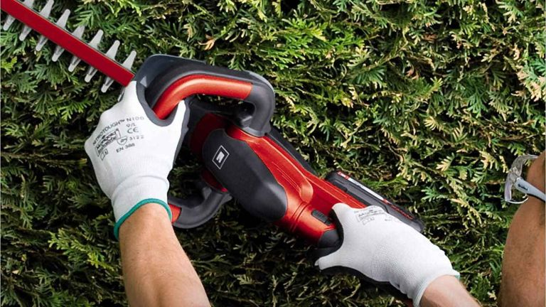 Einhell GE-CH 1846 Li Kit Power X-Change Cordless Hedge Trimmer in use