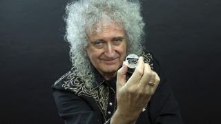 Queen's Brian May with the new £5 coin