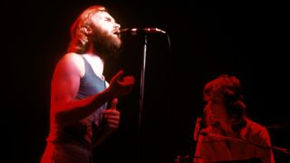 A picture of Phil Collins onstage with Genesis in 1976