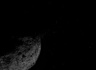 This view of the asteroid Bennu ejecting particles from its surface on Jan. 19, 2019, was created by combining two images taken by NASA's OSIRIS-REx spacecraft: a short-exposure photo, which shows the asteroid clearly, and a long-exposure version, which shows the particles clearly. Other image-processing techniques were also applied, such as cropping and adjusting the brightness and contrast of each layer.