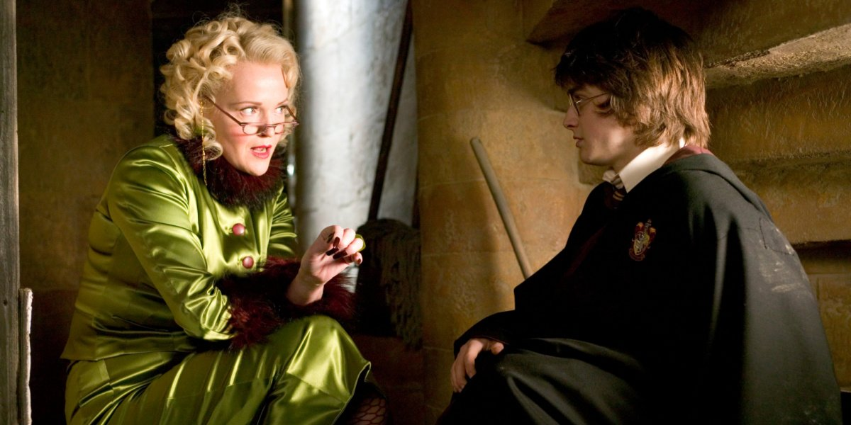 Rita Skeeter with Harry Potter in Harry Potter and the Goblet of Fire.