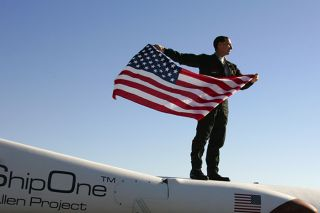 Brian Binnie with flag, x prize, spaceshipone