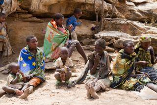 a Hadza family in Mangola, Tanzania.