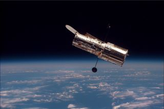 The Hubble Space Telescope as seen from the space shuttle Discovery during the second servicing mission in 1997.