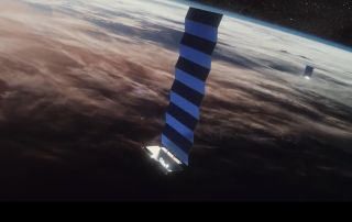 An artist's illustration of SpaceX's Starlink internet satellites in orbit. The company has won a U.S. military contract for missile-warning satellites.