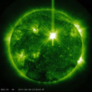 The sun unleashed a powerful Class X1.5 solar flare on March 9, 2011, a solar storm that could supercharge Earth's auroras. The flare was recorded by NASA's Solar Dynamics Observatory and other spacecraft. Here, it appears in white at the upper right of t