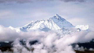 Peak of Mount Everest above the clouds.