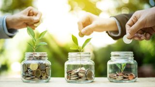 People in suits adding money to jars growing plants