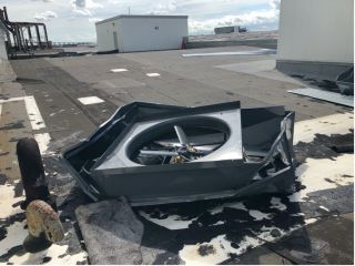 A fan detached and damaged by Hurricane Ida as seen on the roof of the main manufacturing building at NASA's Michoud Assembly Facility in New Orleans.