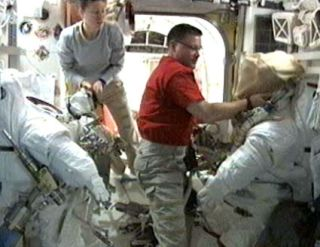 Spacewalking Astronauts Tackle Major Space Station Repair