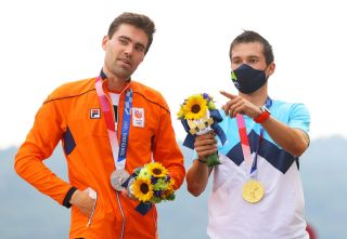 OYAMA JAPAN JULY 28 LR Silver medalist Tom Dumoulin of Team Netherlands and gold medalist Primoz Roglic of Team Slovenia speak on the podium during the medal ceremony after the Mens Individual time trial on day five of the Tokyo 2020 Olympic Games at Fuji International Speedway on July 28 2021 in Oyama Shizuoka Japan Photo by Tim de WaeleGetty Images