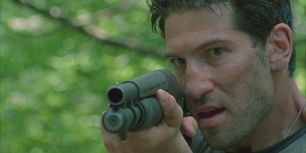 Shane holding a shotgun in The Walking Dead