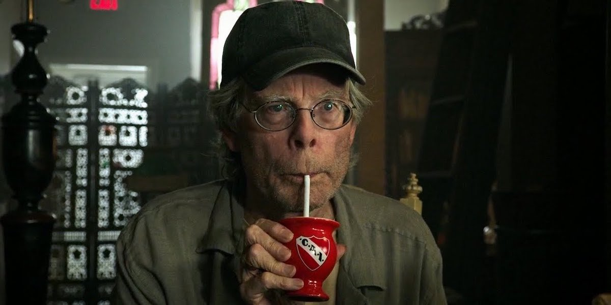 Stephen King, in a cameo from 'It Chapter Two,' drinks from a straw.
