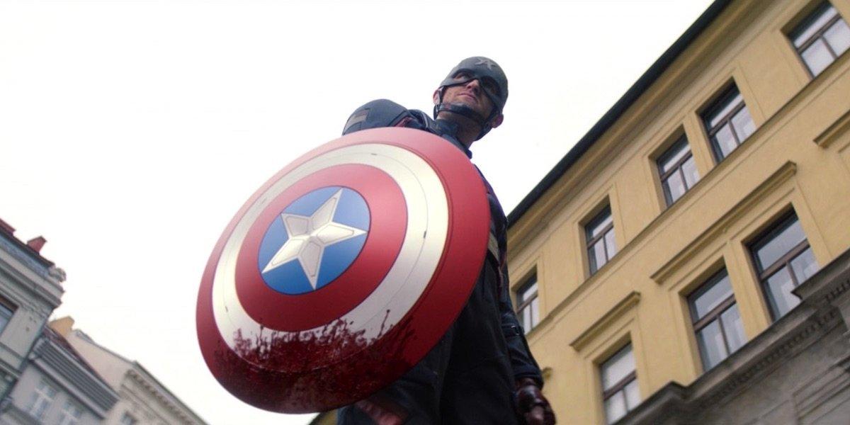 Wyatt Russell as John Walker holding bloody Captain America shield