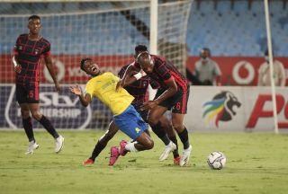 Mlungisi Mbunjana of TS Galaxy fouls Themba Zwane of Mamelodi Sundowns