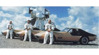 Apollo 12 astronauts Pete Conrad (left), Richard Gordon (center) and Alan Bean with their AstroVette Corvettes and a lunar lander in a crew portrait from 1969.