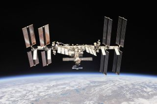 A photograph of the International Space Station in orbit around Earth.
