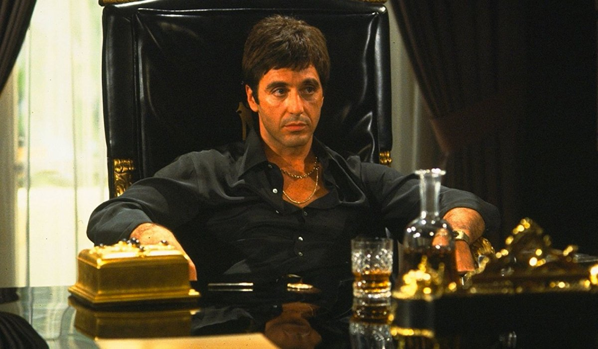 Al Pacino sits imposingly at his ornate desk in Scarface.