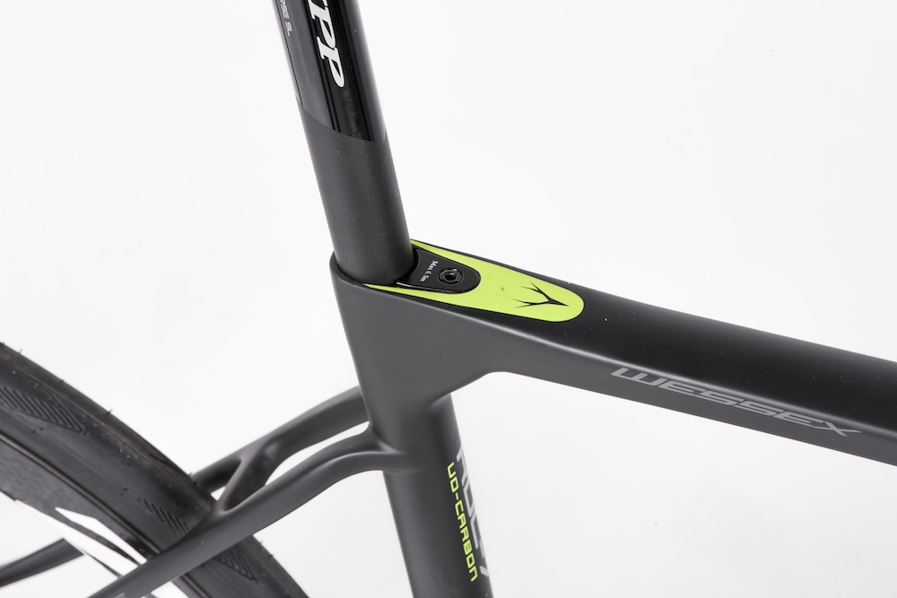 Dropped, thin seat stays boost comfort. The seat post bolt is very neat too