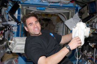 NASA Astronaut Settles in Aboard Space Station
