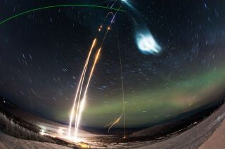 A timelapse image shows three suborbital rockets launching the Super Soaker mission.