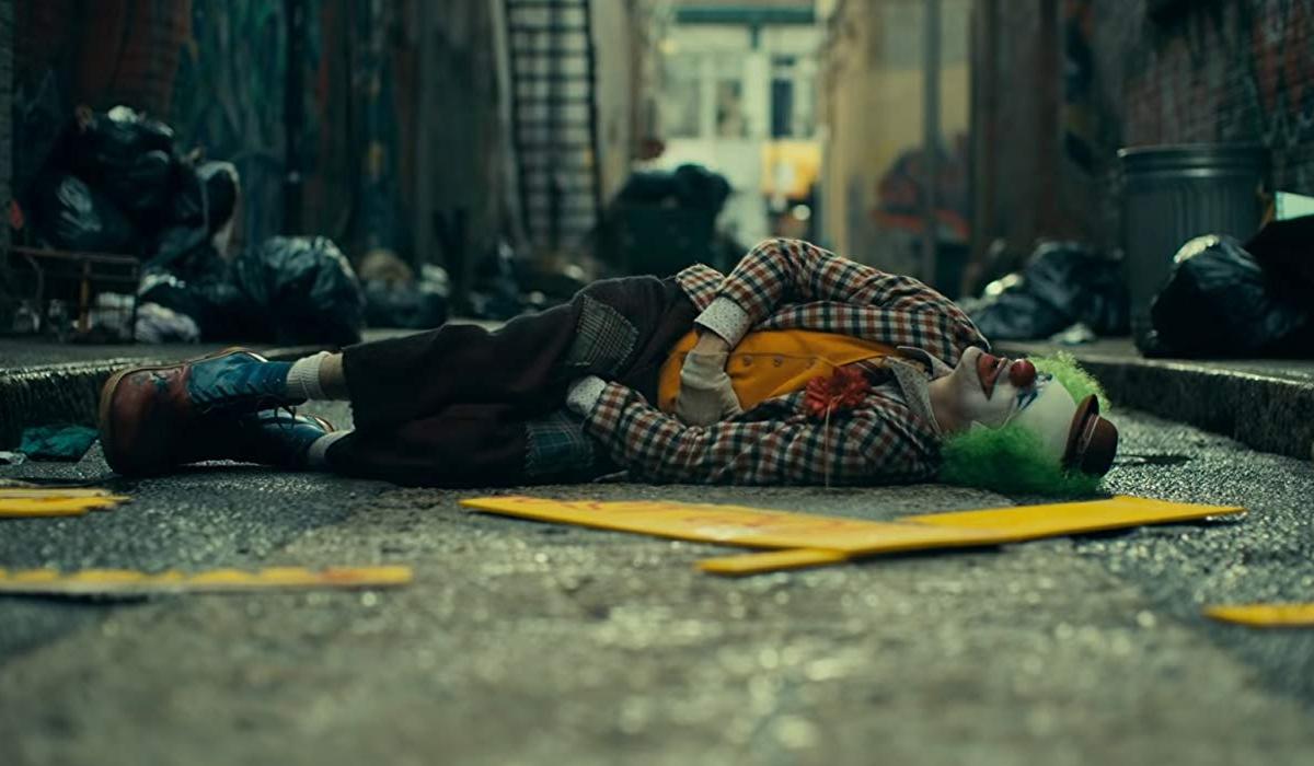 Joker Arthur lies in the street, after being beaten
