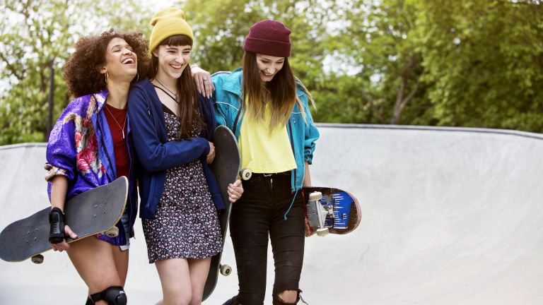 Group of skateboarders laughing together