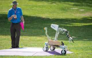 A robot built by the team Formicarum rolls off its starting platform during a level one rerun at NASA's 2015 Sample Return Robot Challenge on Friday, June 12, at the Worcester Polytechnic Institute (WPI) in Worcester, Mass. Sixteen teams are competing for