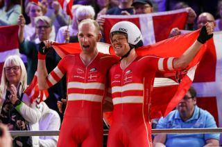 Denmark's Michael Mørkøv (left) and Lasse Norman Hansen celebrate after winning the men's Madison at the 2020 UCI Track World Championships in Berlin, Germany