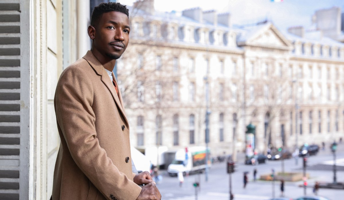 Uncorked Mamoudou Athie on a balcony in Paris